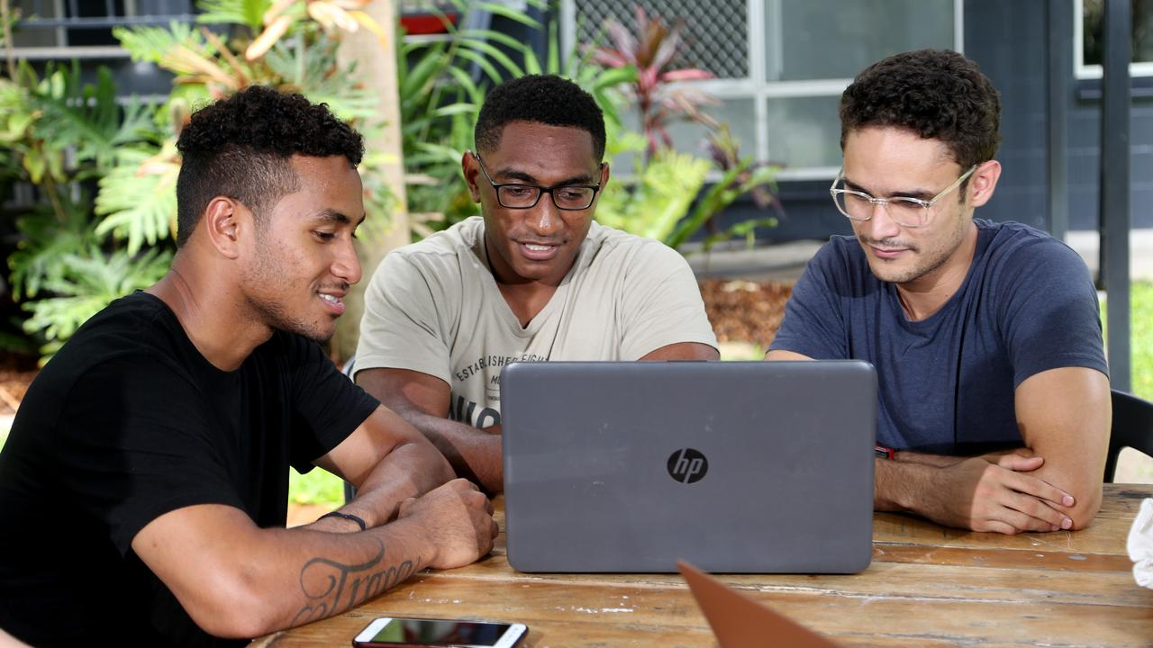 Education tourism is growing in Cairns, with two universities taking increasing numbers of overseas students. Cairns Student Lodge tenants Pagave Puana, 23 from PNG Newman Kenamu, 21 from PNG, and James Steven 22 from Thursday Is at their Smithfield accommodation ahead of starting studies in Cairns. PICTURE: STEWART MCLEAN