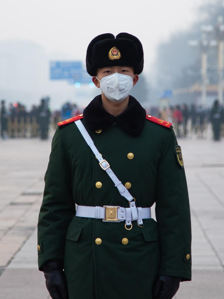 A police officer wearing a mask at Tiananmen Gate. Picture: Betsy Joles/Getty Images.