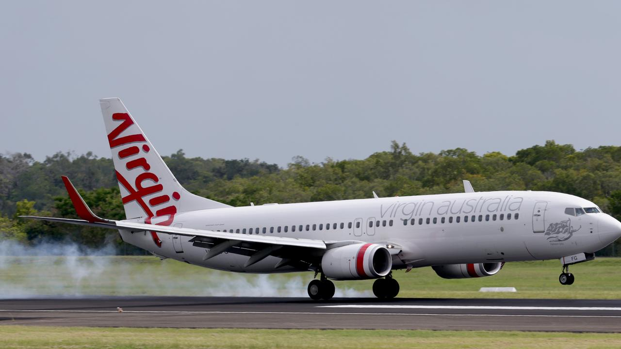 A Virgin Australia flight at Cairns Airport.