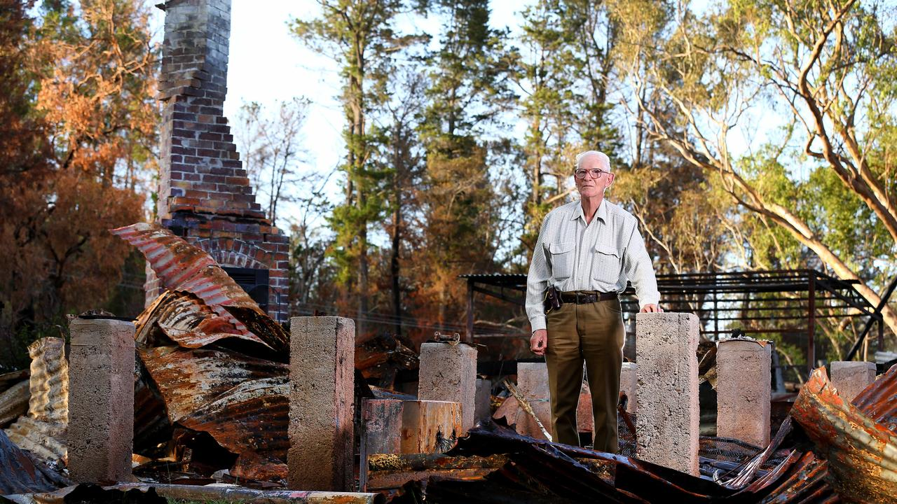 Stanthorpe resident Alain Bourzali returns to his home that was totally destroyed during the fires. He won't be rebuilding it. Picture: Adam Head