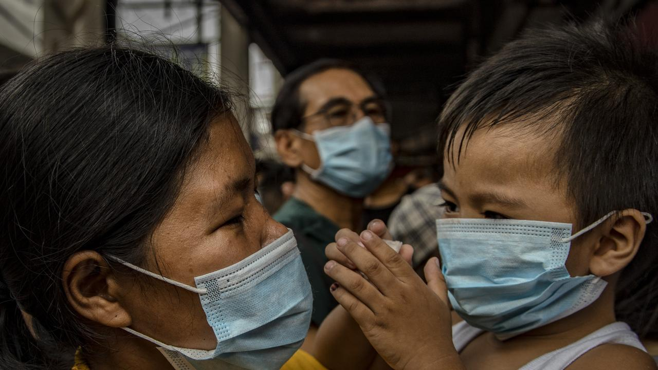 Filipinos wearing face masks in Manila, Philippines, where the government has been heavily criticised for failing to immediately implement travel restrictions from China. Picture: Ezra Acayan/Getty Images