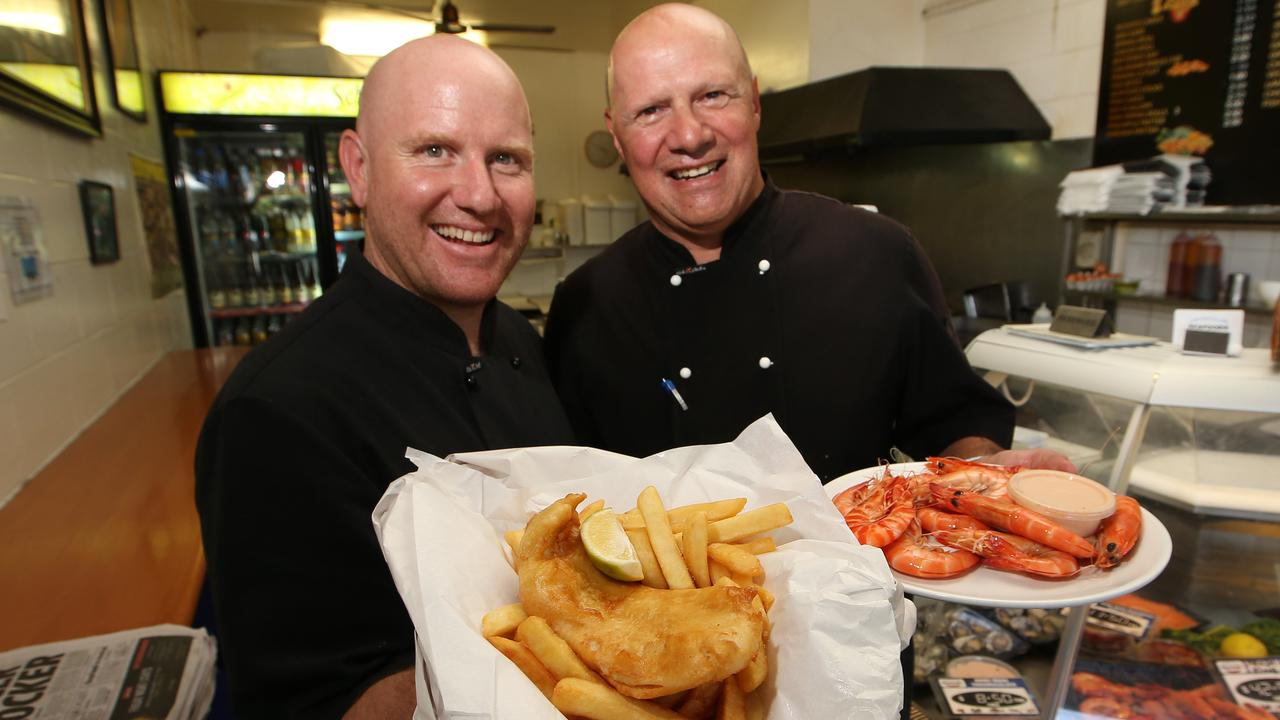 Chevron Island Seafoods wins best of the Gold Coast: fish and chips. Warren Ebbels and Frank Vayonitis with their award-winning food. Picture Glenn Hampson