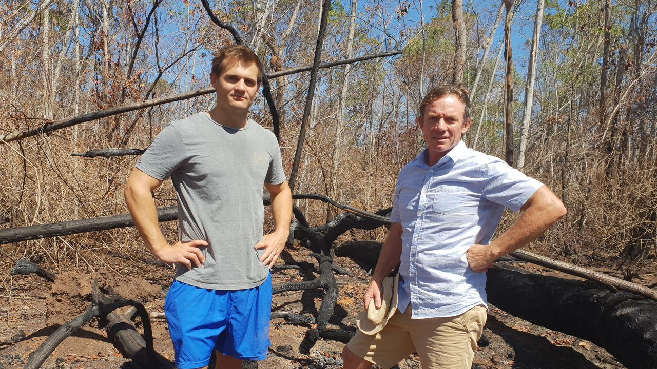 Limestone Creek Road resident Rhys Stafford, who lives on his uncle Steve Stafford's property, shows Cr Adam Belot the devastation caused by last November's Cobraball bushfires. Photo Darryn Nufer.