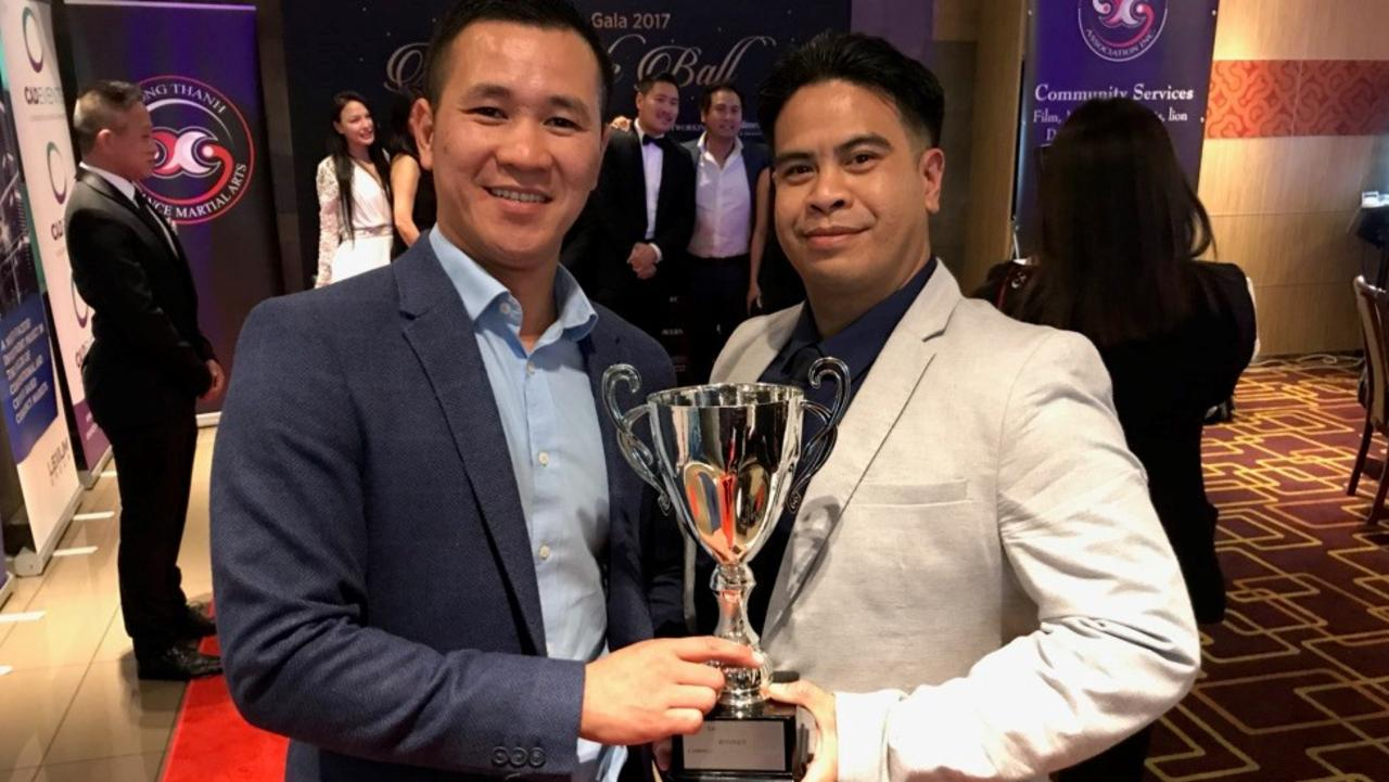 INSPIRATION: Vu Pham with his mentor and pastor Tony Hoang after receiving an award for making a positive impact on the community. Photo: Contributed.