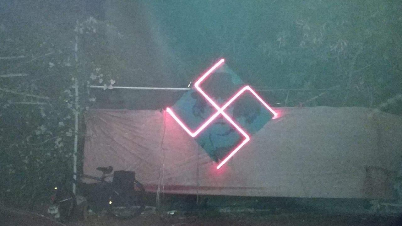 The neon swastika hanging on a fence in Stuart Park. Picture: Supplied