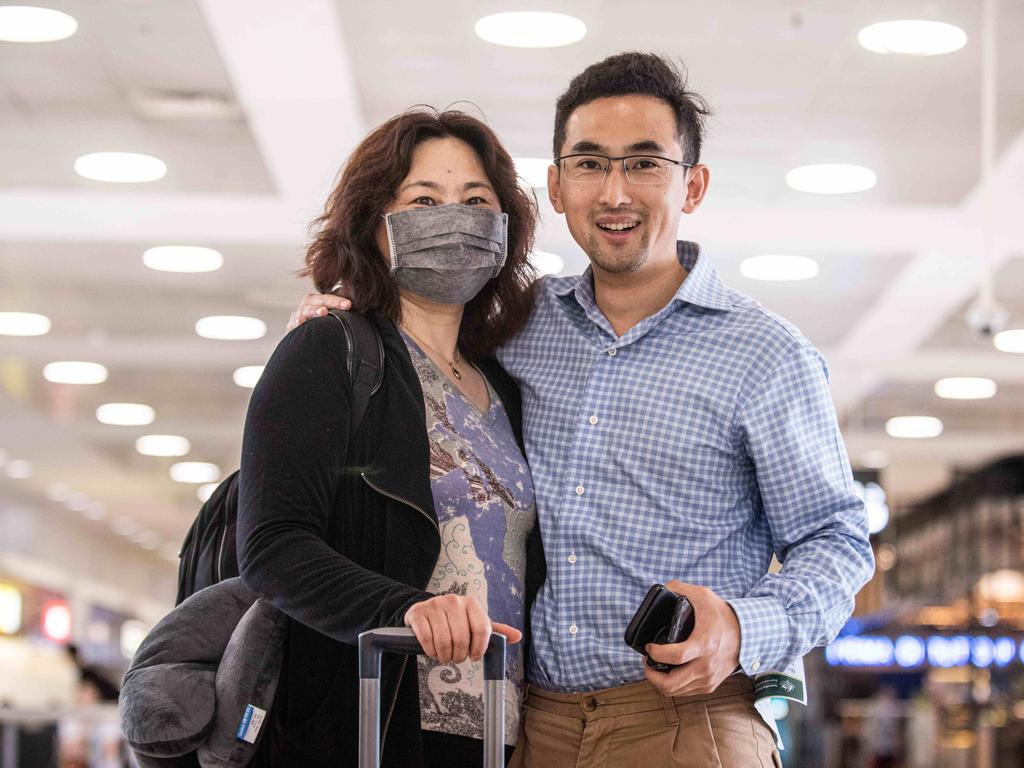Lu Chong and her son William arrived from Beijng at Sydney International Airport. Picture: Daily Telegraph/Flavio Brancaleone