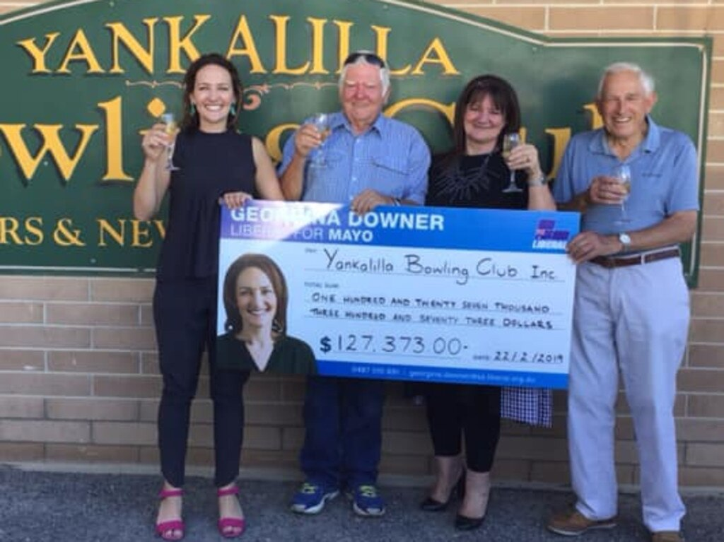 Georgina Downer presents a giant novelty cheque to the Yankalilla Bowling Club in February 2019. She would go on to lose the election in Mayo to Centre Alliance's Rebekha Sharkie. Picture: Georgina Downer – Liberal for Mayo/Facebook