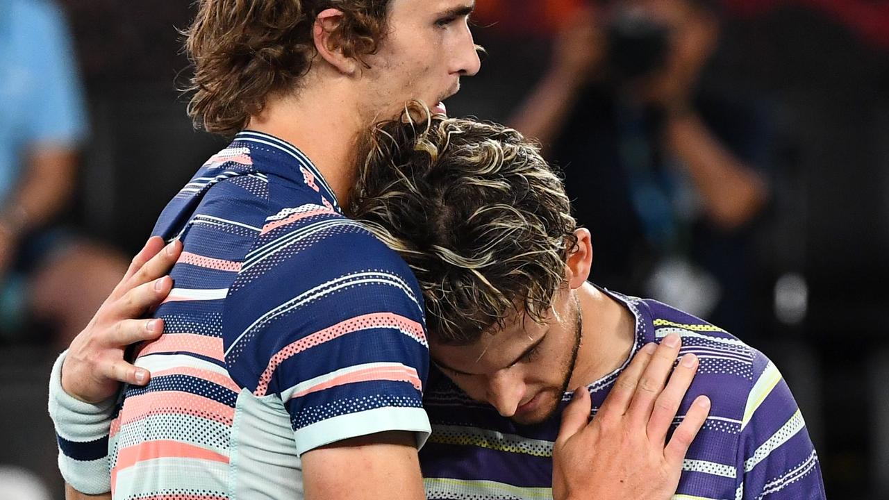 Alexander Zverev embraces Dominic Thiem after losing to the Austrian on Friday night.