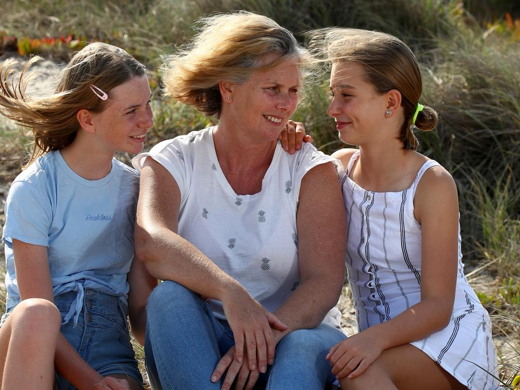 Katrina Condie lost her Conjola Park home in the New Year's Eve fire. Pictured with daughters Sienna 14 (L) and Grace 11. Picture: Toby Zerna