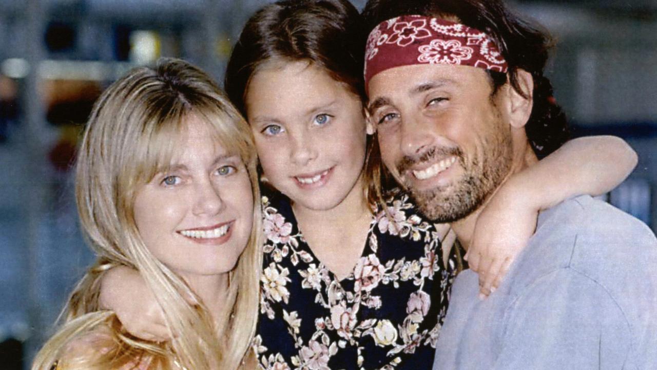 Lattanzi with parents Olivia Newton-John and Matt Lattanzi in Sydney in 1993. (Picture: Supplied)
