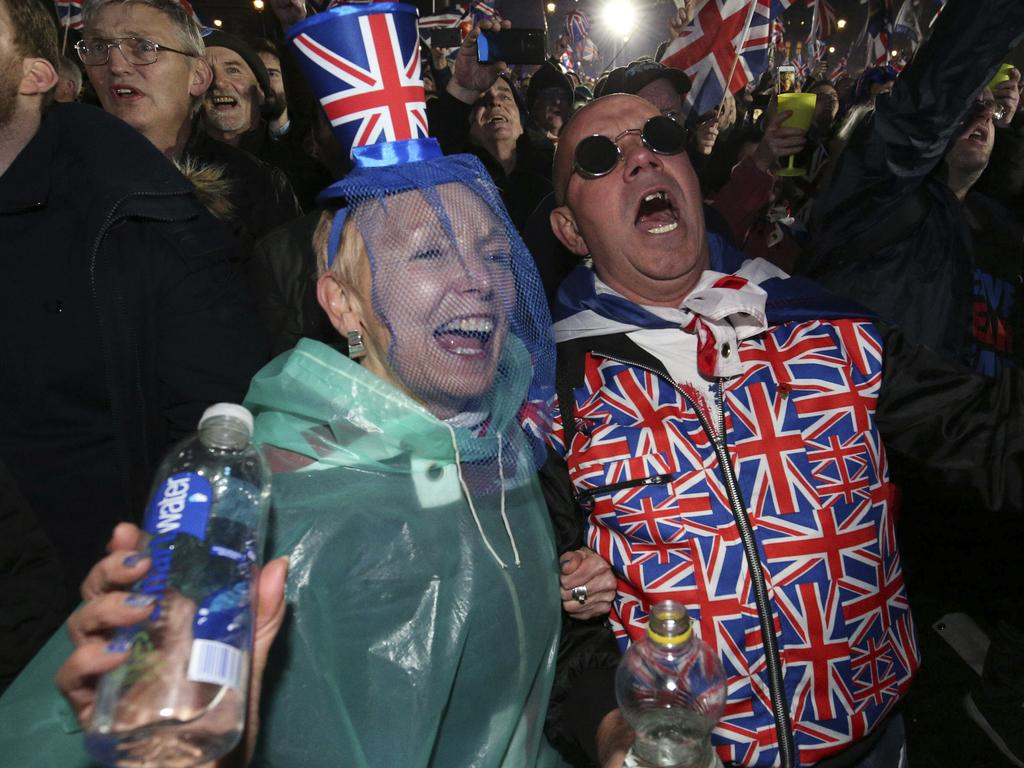 Brexit supporters celebrate during a rally in parliament square in London, England. Picture: AP
