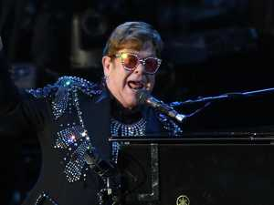 Elton John flees stage as flash storm hits