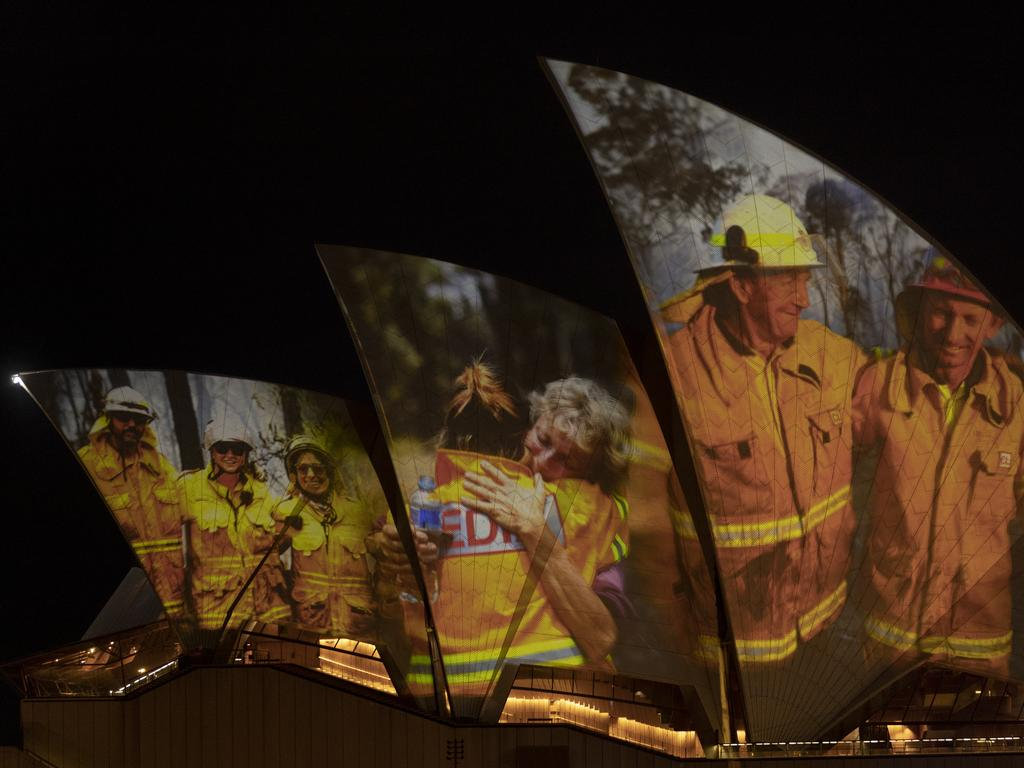 Images of firefighters projected on the sails of Sydney Opera House. Picture: Brook Mitchell/Getty Images