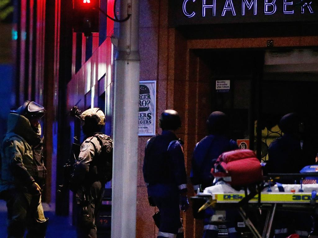 The bomb squad prepares to enter the cafe after the TOU shot dead gunman Man Monis. Picture: Daniel Munoz