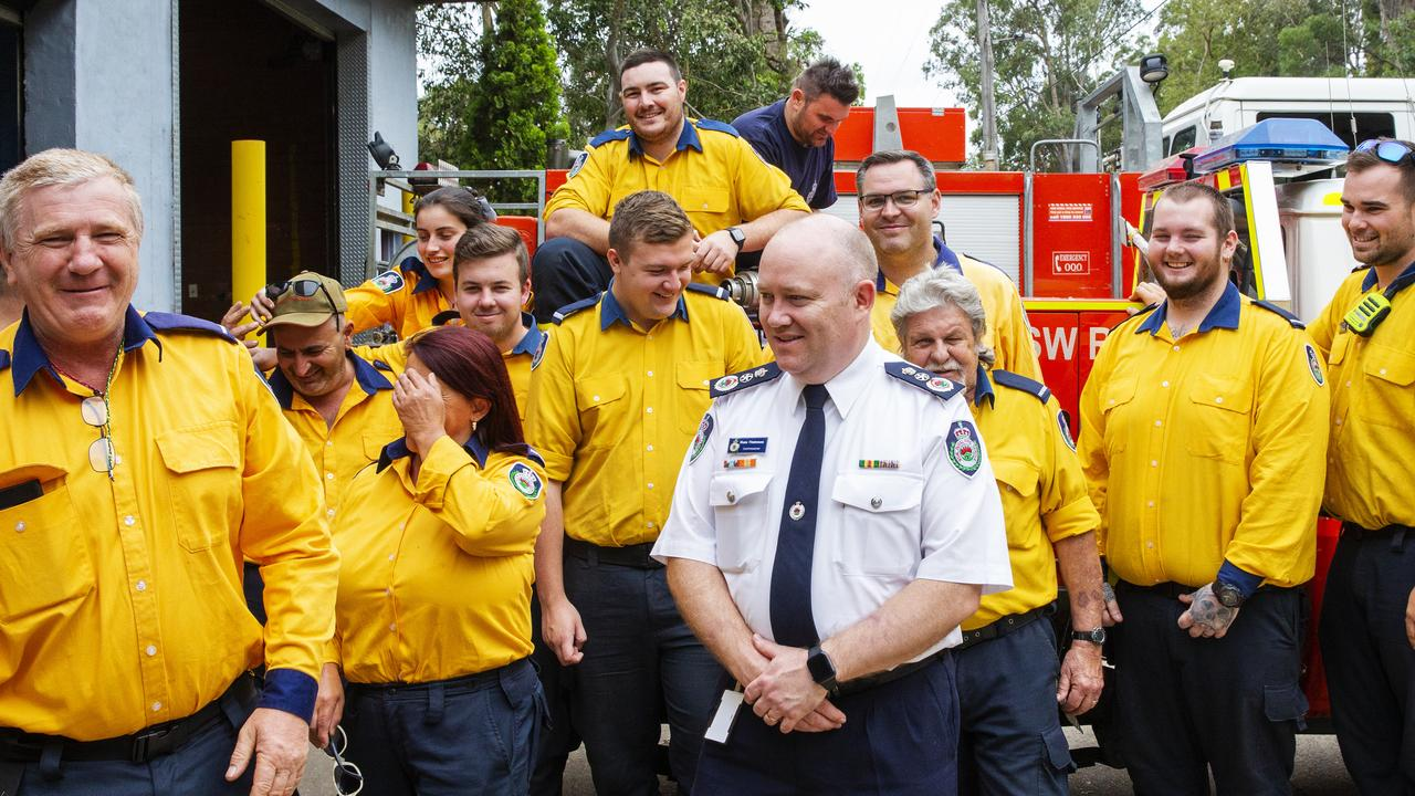 Commissioner Shane Fitzsimmons (centre) talks to RFS members at Horsley Park. Picture: Jenny Evans/Getty Images