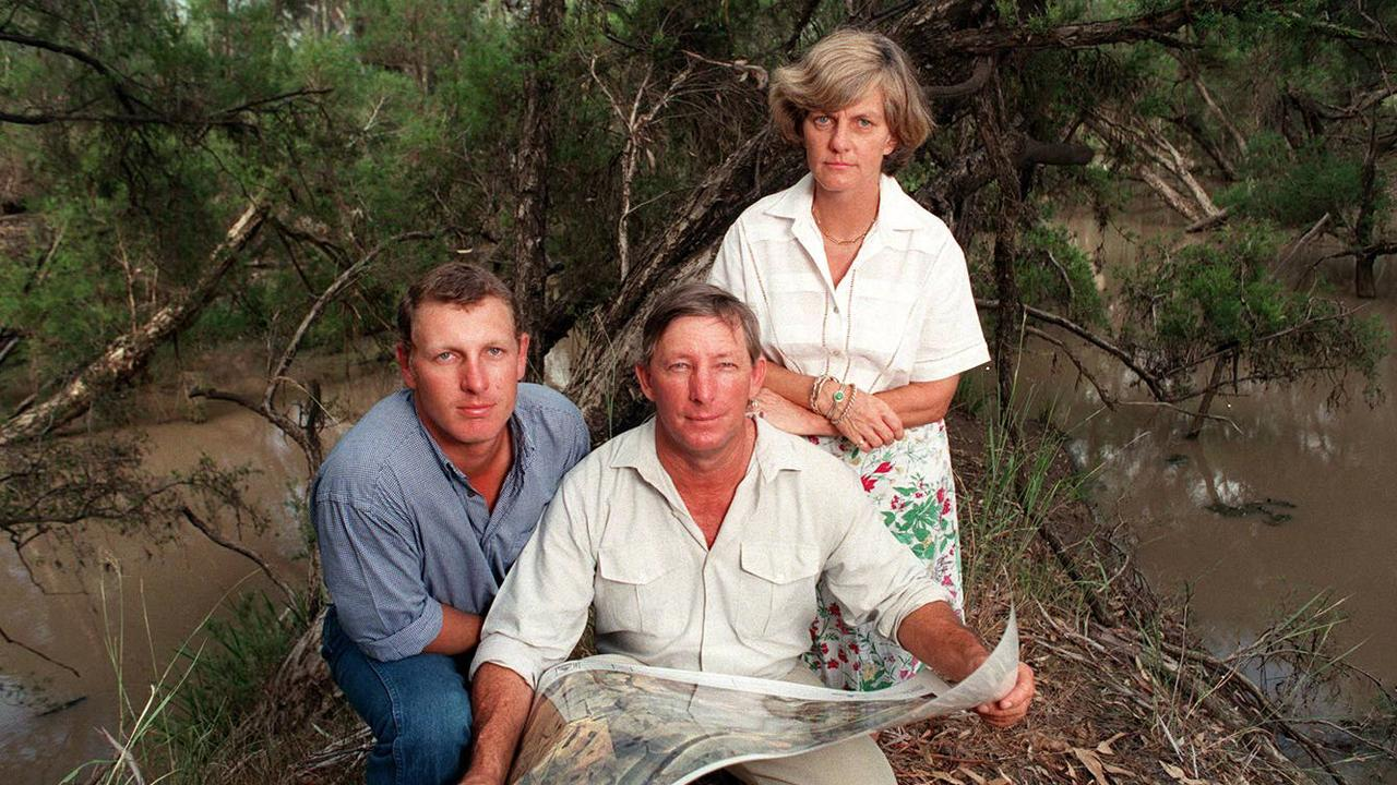 OLD PROJECT: Grazier Don Joyce with wife Margaret and son Ben with map of area at Nathan Dam, taken back in 1998.