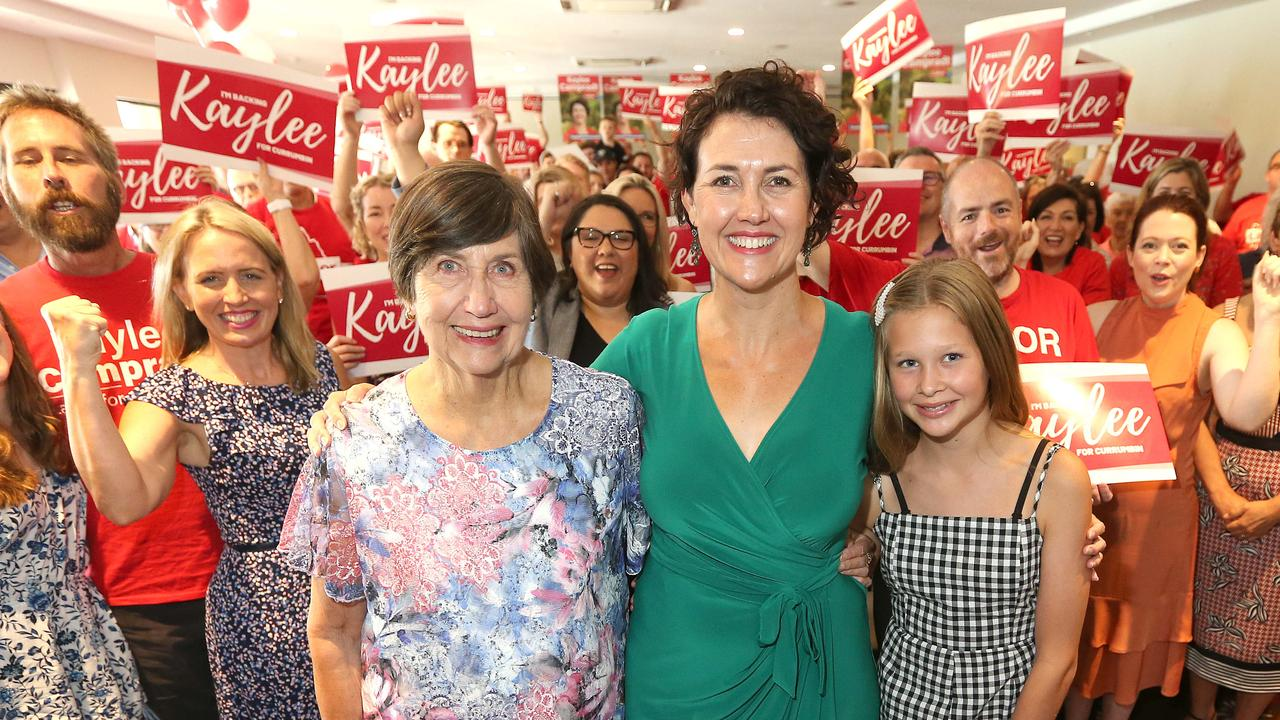 Labor's Currumbin candidate Kaylee Campradt (centre) with her mum Mavis Campradt and daughter Indie Campradt, 13. Pictured behind Mavis Campradt is Minister for Tourism Kate Jones. Picture: Mike Batterham