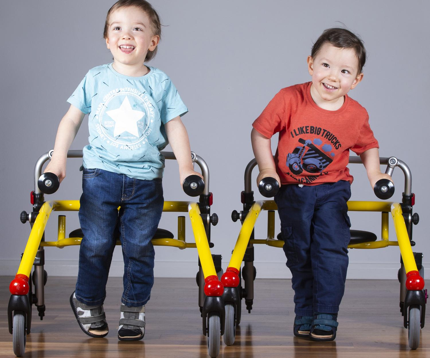 William and Benjamin Rosuck in their walkers. Picture: AAP/Renae Droop