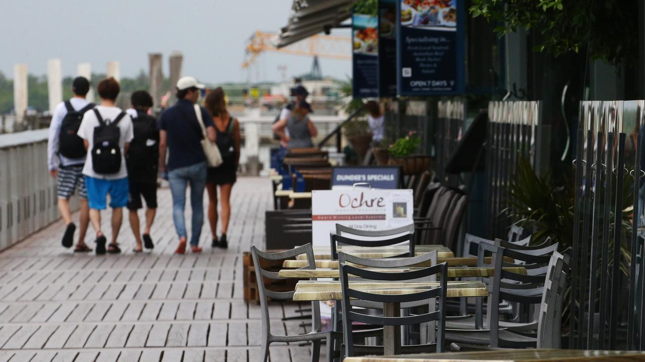 Restaurant tables on the Cairns waterfront sit empty as tourist numbers fall and tourism related businesses suffer a loss of income. Picture: Brendan Radke