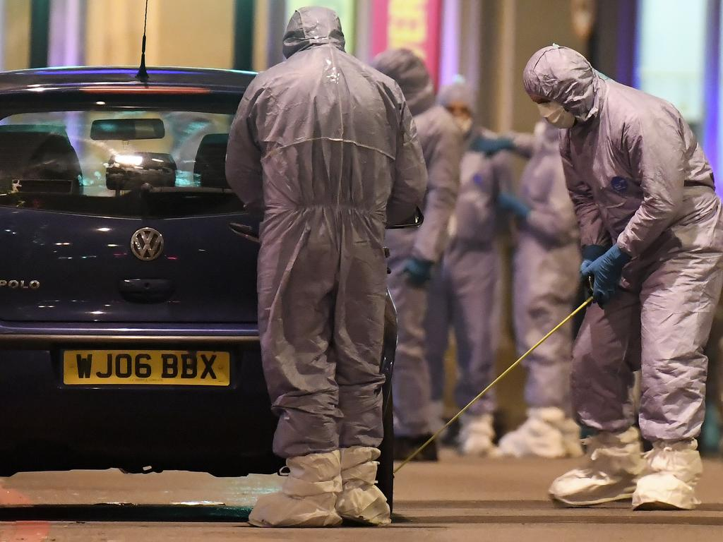 Police forensic officers working near the scene of a stabbing incident in Streatham, London. Picture: Alberto Pezzali