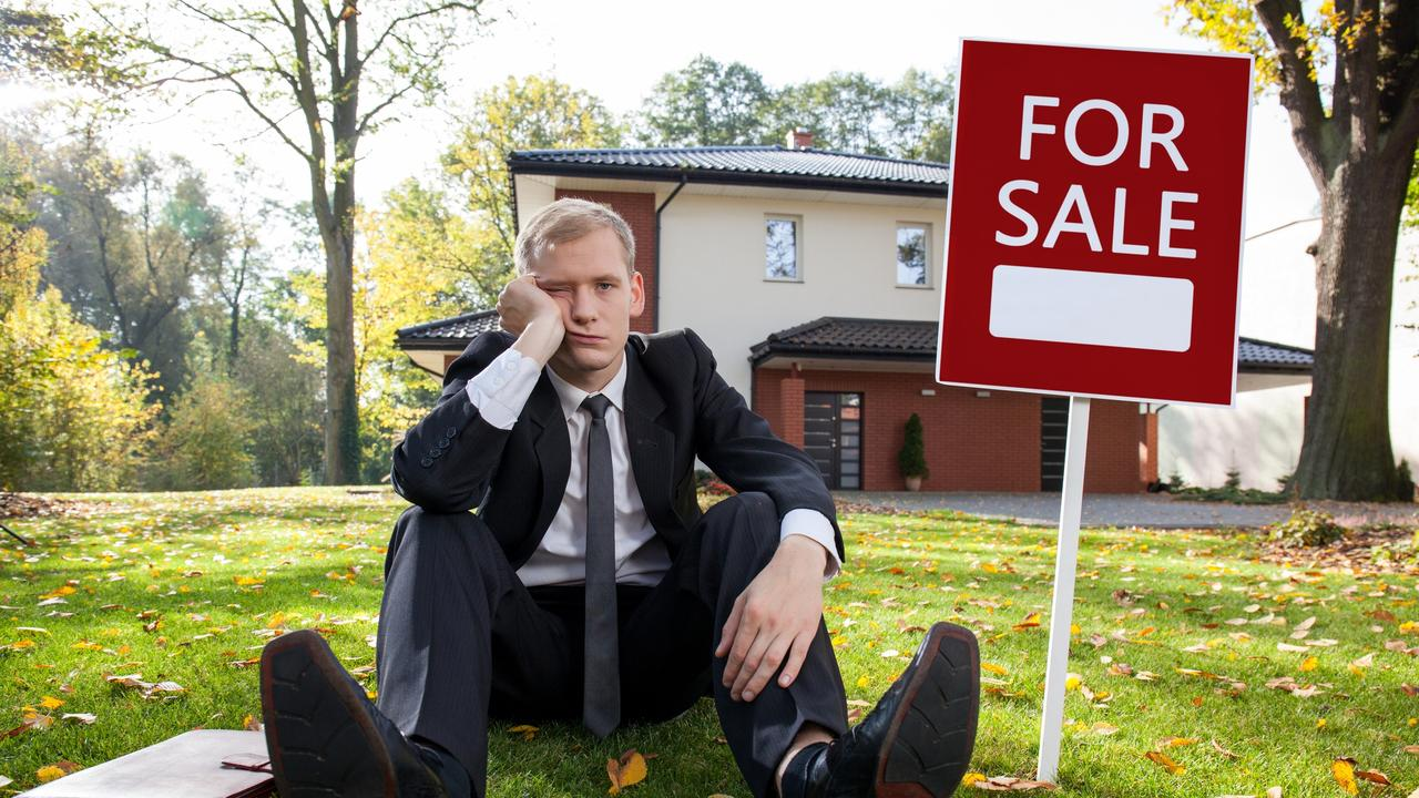 Worried real estate agent and house for sale, sad, generic housing