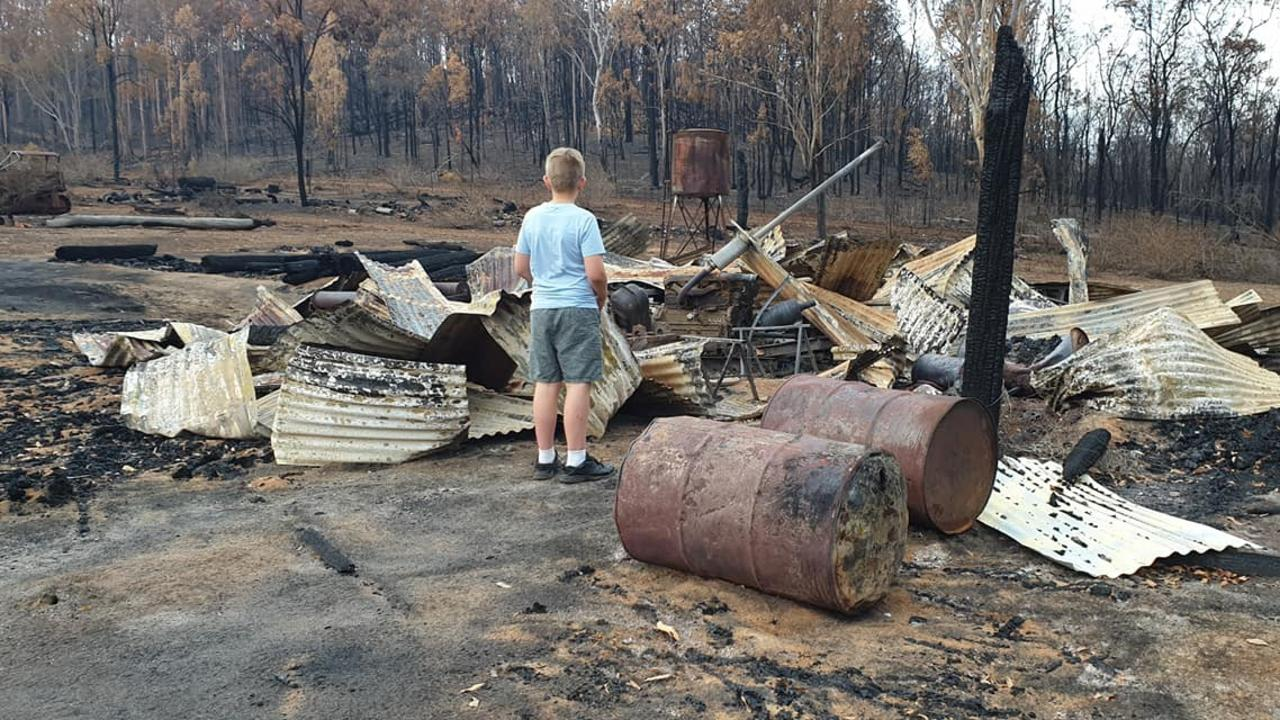 DESTROYED: 11-year-old Harrison looks at the bushfire damage on the Limberg family's farm near Esk.