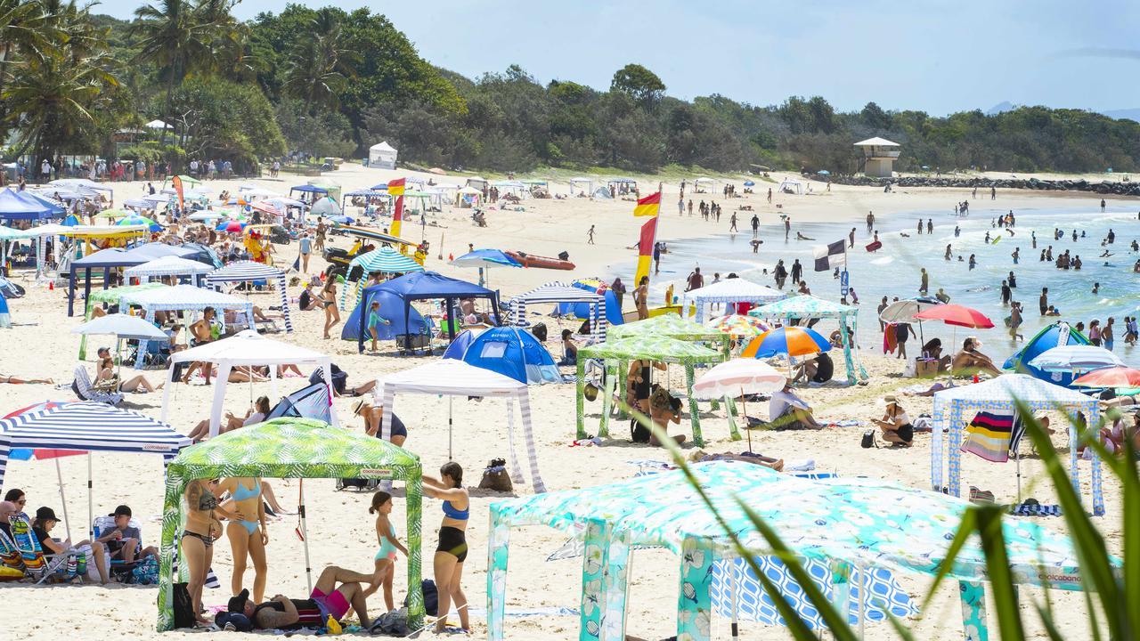 Beachgoers at Noosa on Australia Day. Photo Lachie Millard