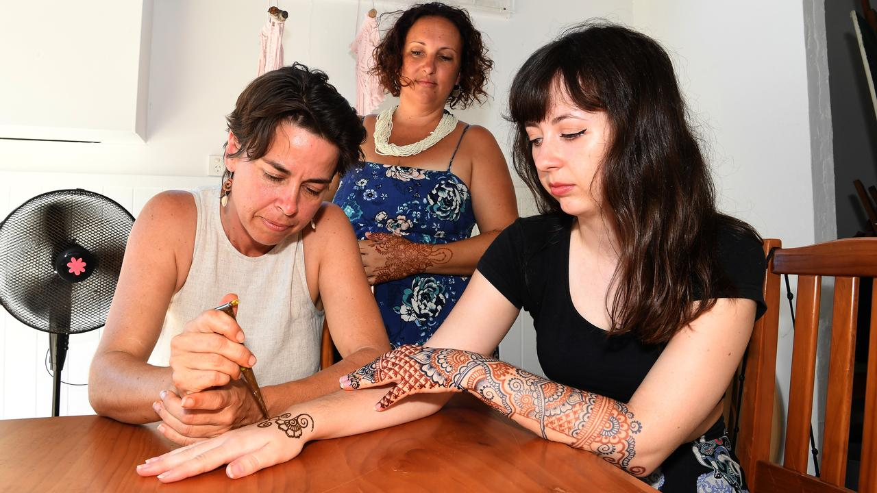 HEALING ART: Nicki Coquillard, Alicia Mireille and Calen Brae Lingard are creating cancer crowns for women fighting cancer. Picture: Warren Lynam