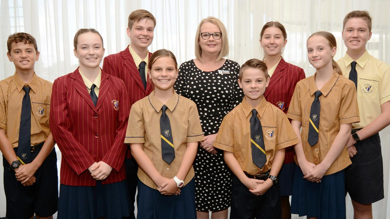 Holy Spirit College's new principal Alison Wales with students. Back row, from left: Lachlan Mattes, Meg McDonald and Jack Thatcher; front row, from left: Mason Henderson, Kate Miles, Olivia Tickle, William McBurney and Sienna McDonald.