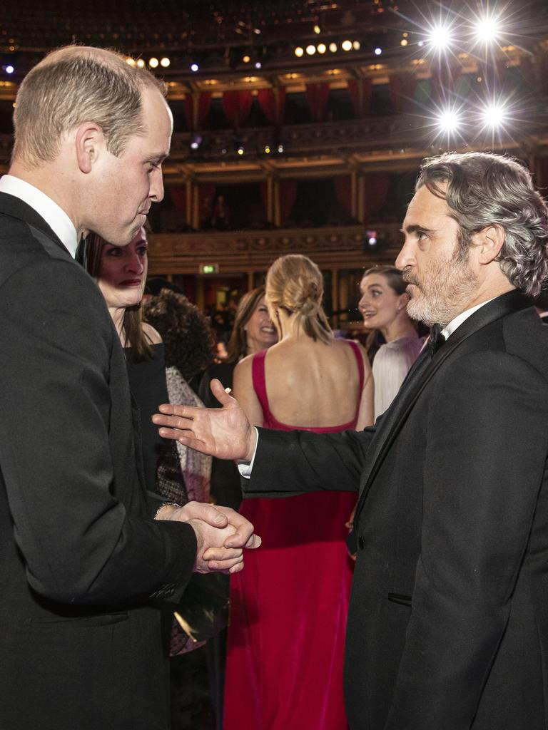 Prince William speaks with BAFTA winner Joaquin Phoenix at the awards. Picture: Getty