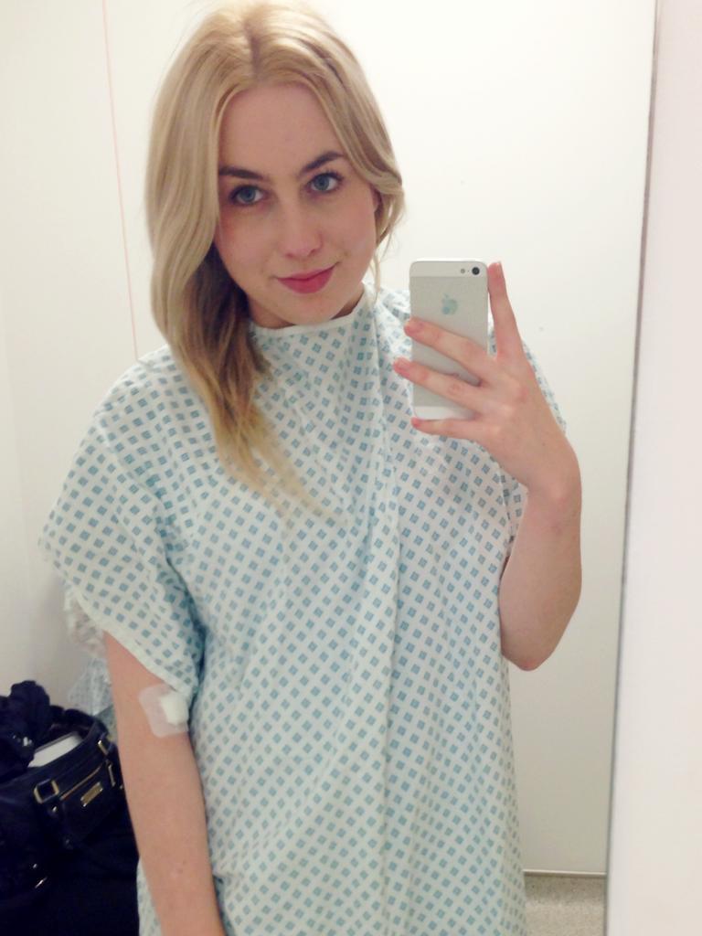 Kristen Larsen in hospital robes