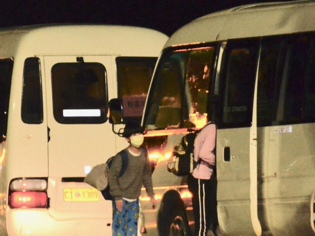 Australian evacuees from Wuhan have arrived on Christmas Island and been loaded onto mini buses. Picture: Sharon Tisdale