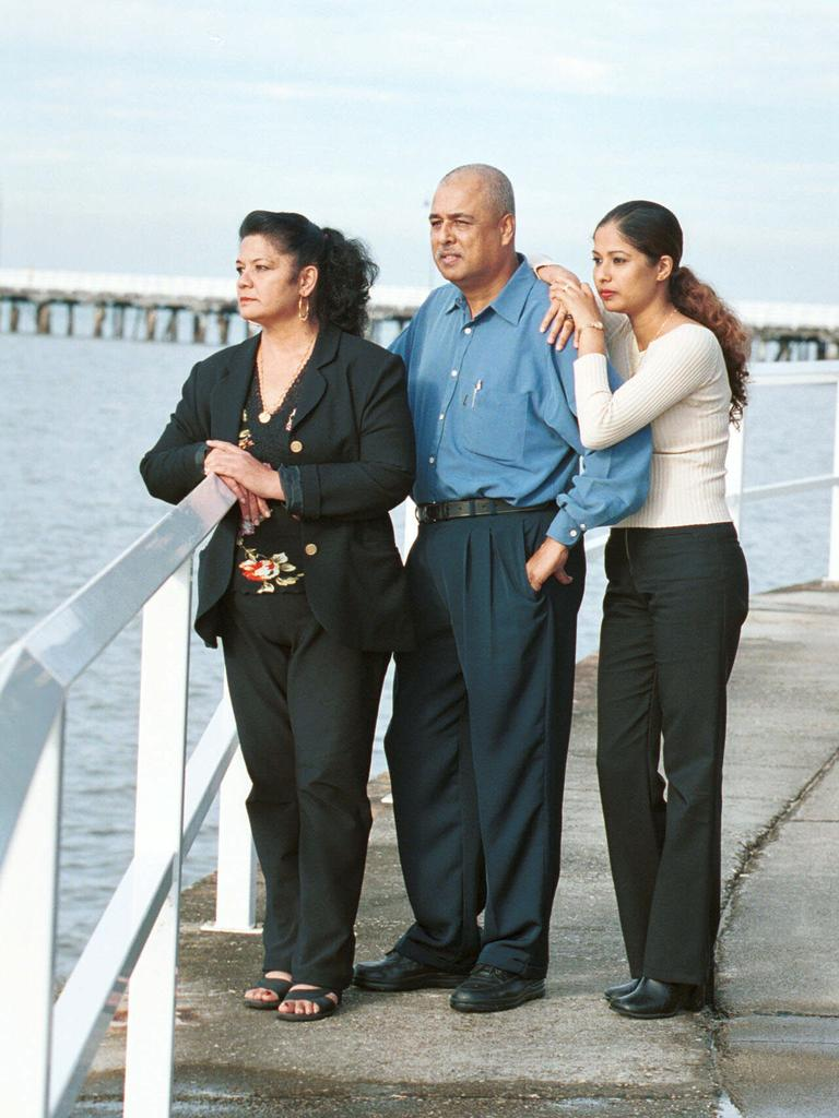 Sonia (daughter), Vijay (father) and Shirley (mother) take time out at the Sandgate jetty after the murder of their children and siblings Neelma, Kunal and Sidhi.