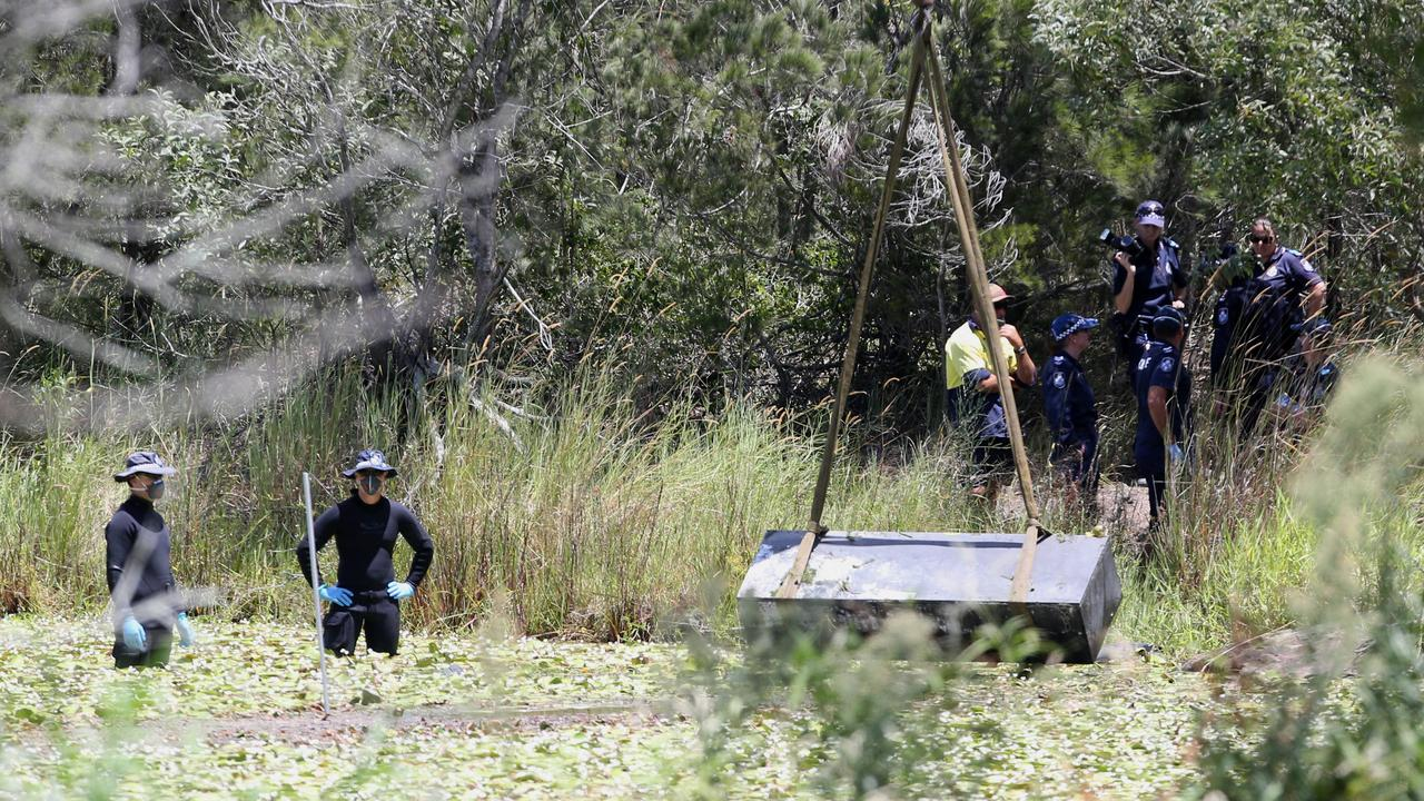 Police retrieve the toolbox with the bodies inside. Picture: Jono Searle.
