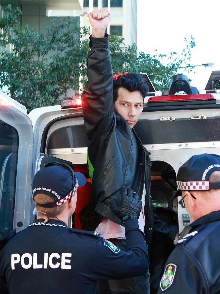 Brooks gestures while being arrested at a protest last year.
