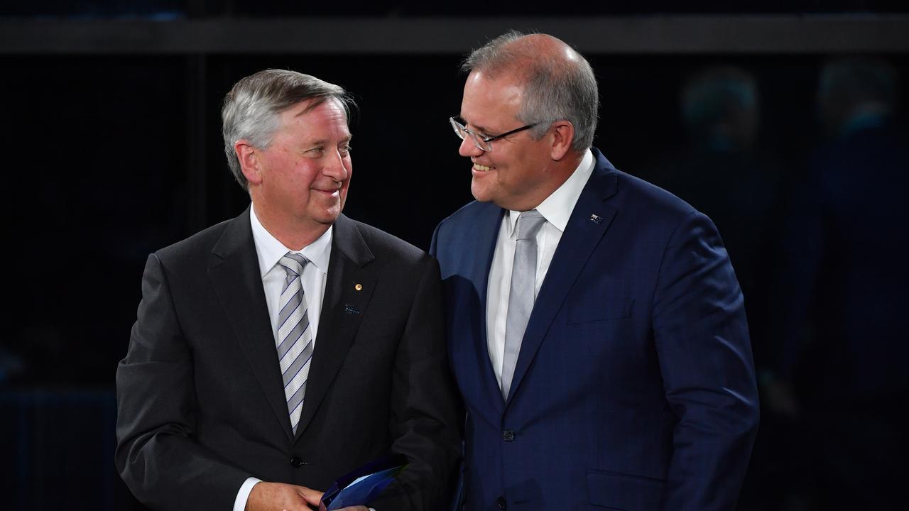 Prime Minister Scott Morrison with 2020 Senior Australian of the Year winner Professor John Newnham.