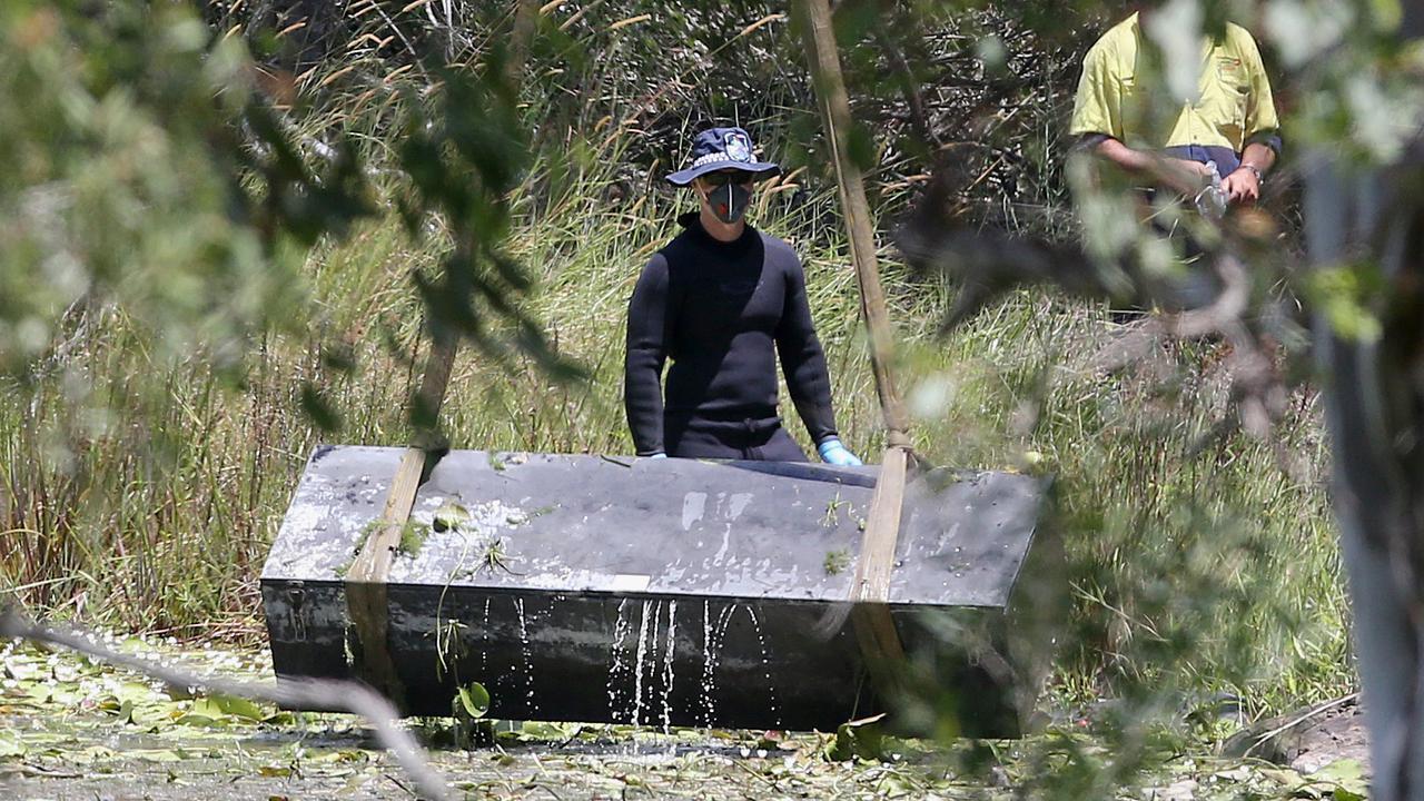 Police retrieve a large metal toolbox from a dam near Scrubby Creek, Kingston, four years ago.