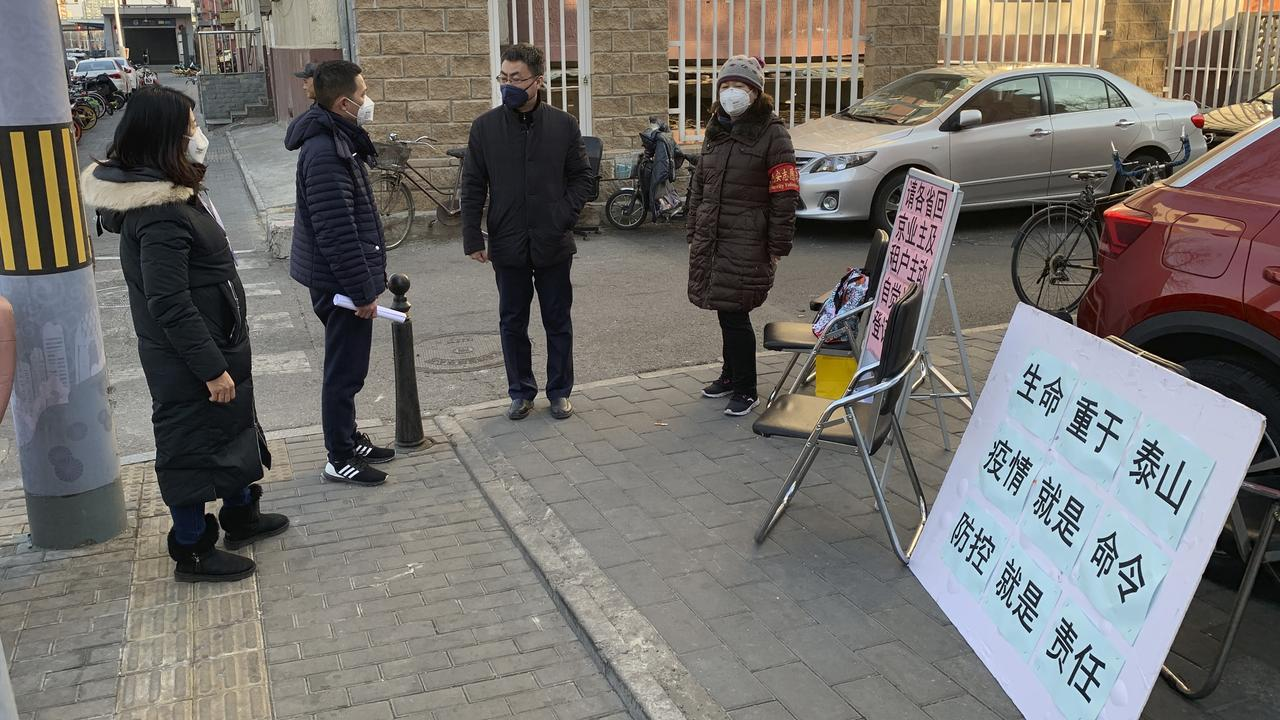 A stall to register residents who have recently returned from other provinces in a neighbourhood in Beijing. Picture: Dake Kang/AP