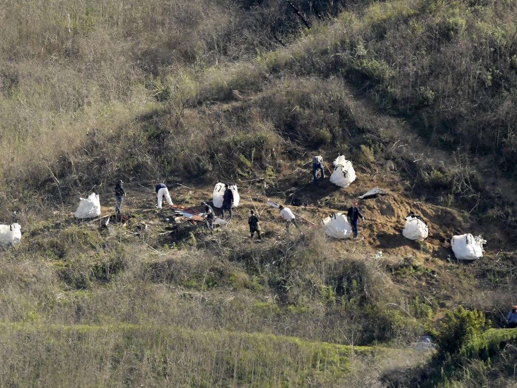 Investigators work at the scene of a helicopter crash that killed Kobe Bryant, his 13-year-old daughter, Gianna, and seven others, in Calabasas. Picture: AP