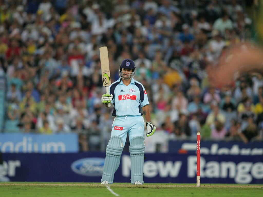 Andrew Johns raises his bat after scoring his first first-class run.