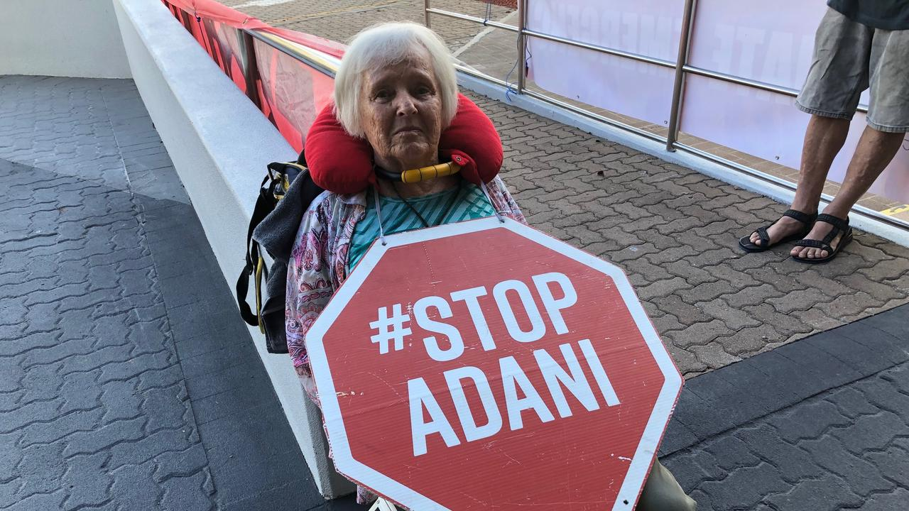 Barb Nielsen, 75, locked herself to a handrail by her neck outside of the Adani headquarters in Townsville.