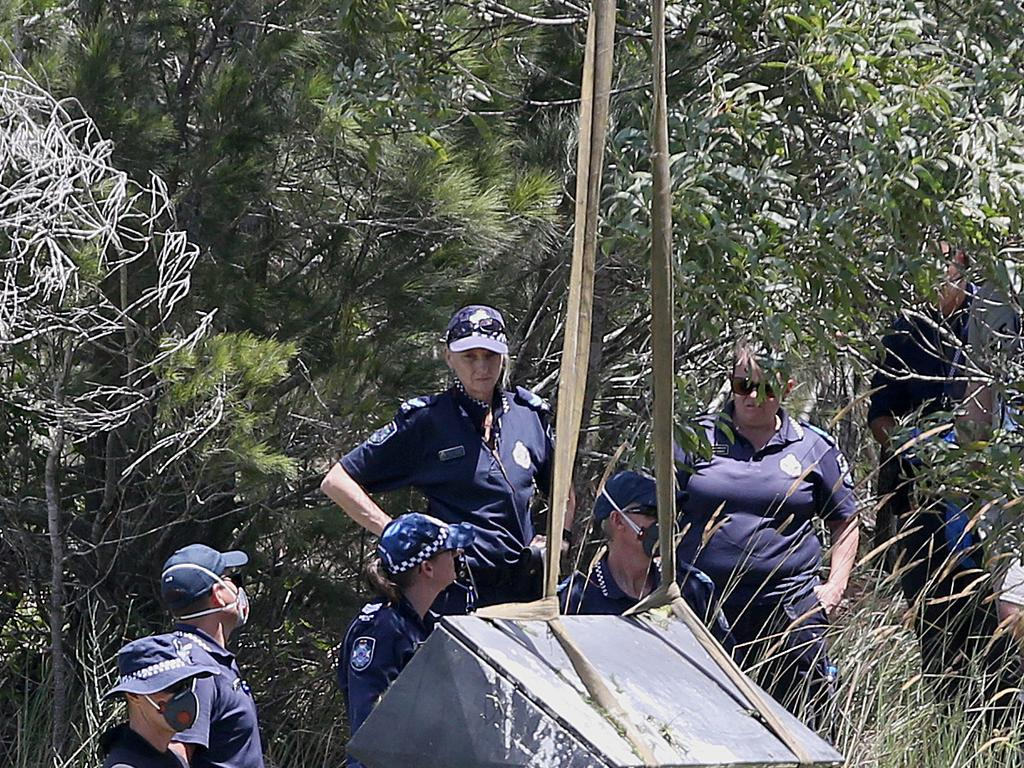 Police retrieve a large metal toolbox from a dam near Scrubby Creek, Kingston, four years ago.