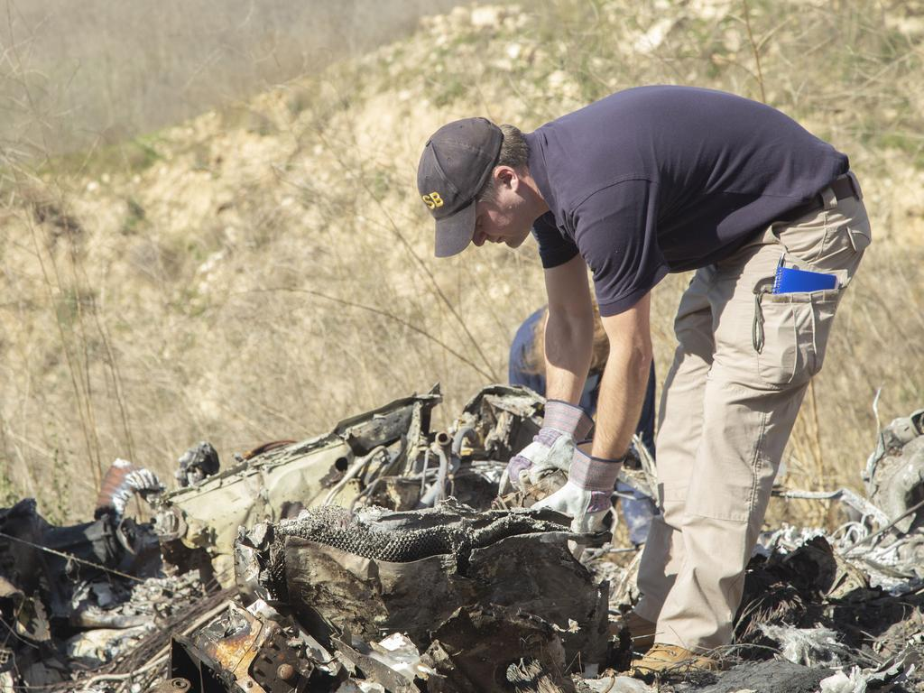 IAn investigator at the scene of the crash. Picture: AP