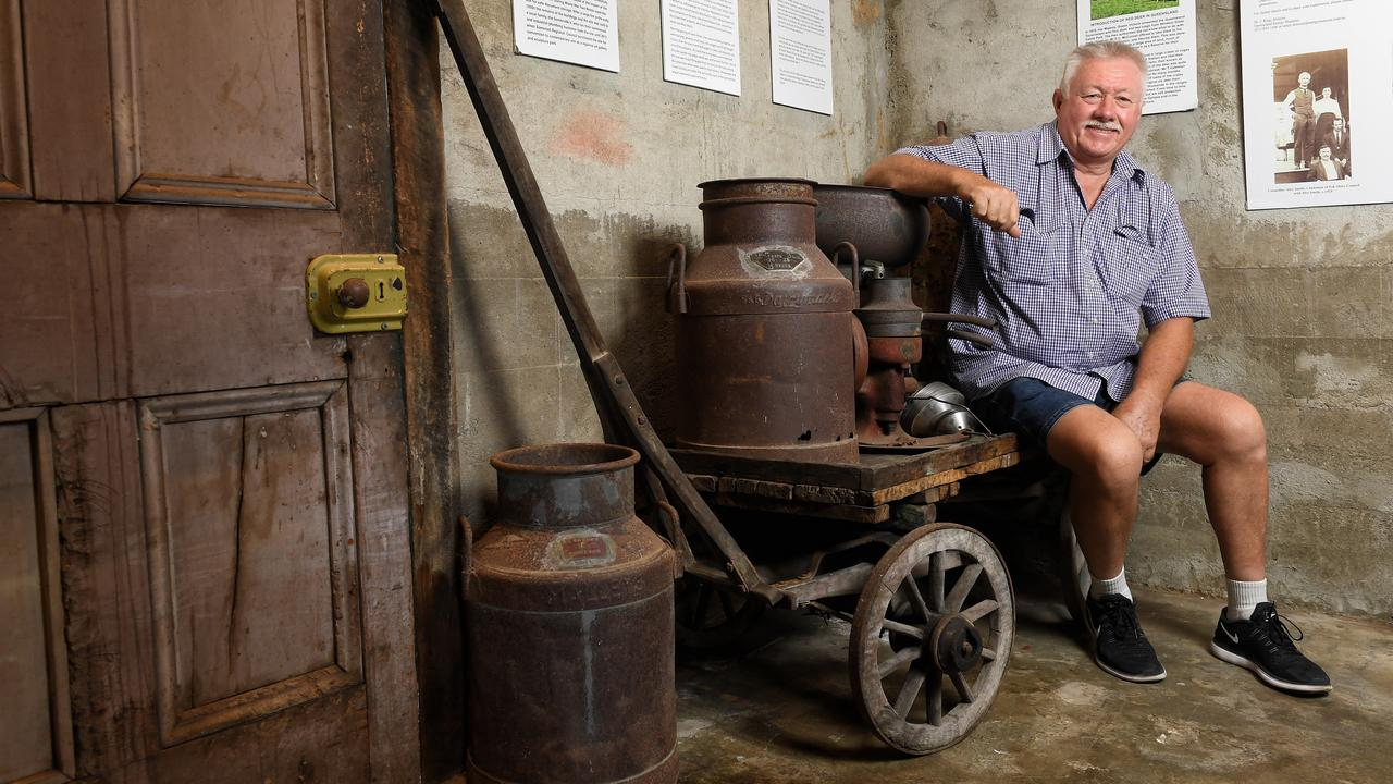 Tim Cannell with a quarter size wagon built and used by his grandfather, Frank Cannell.