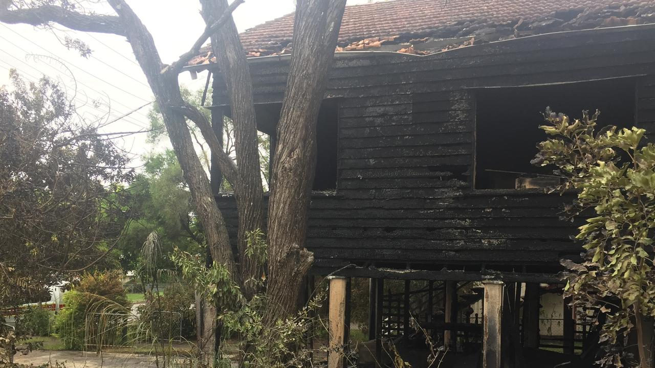 A Chermside house is in ruin and a woman fighting for life in hospital after a fire early this morning. Picture: Cormac Pearson