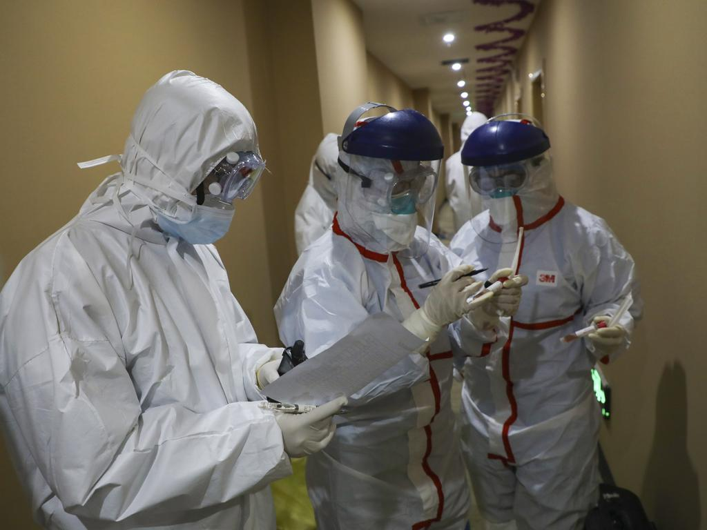 A Chinese medical worker after collecting a sample for nucleic acid tests from a suspected virus patient at a hotel being used to place people in medical isolation in Wuhan. Picture: AP