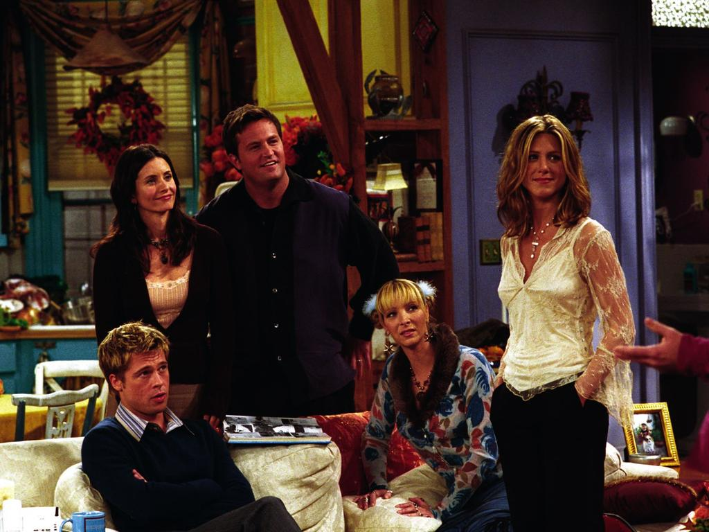 Guest actor Brad Pitt (seated) with regular cast (L-R) Courtney Cox Arquette, Matthew Perry, Lisa Kudrow and Jennifer Aniston. Picture: Supplied