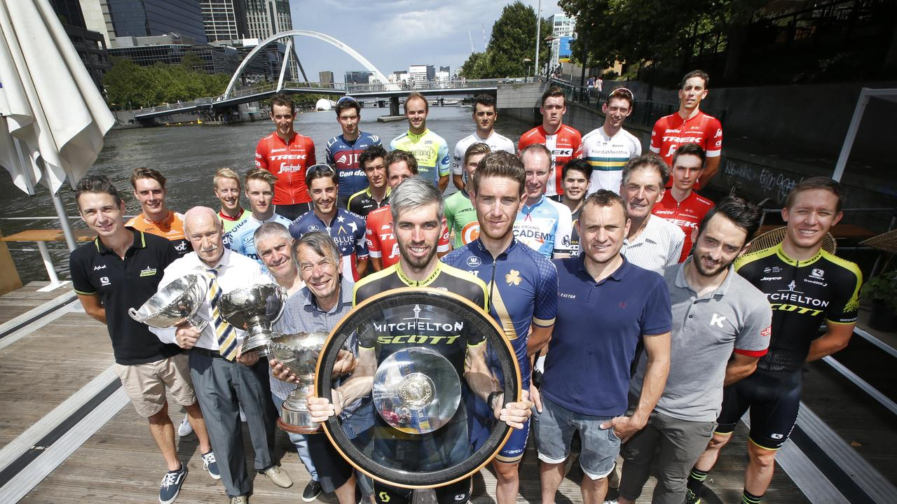 Damien Howson holds the Jayco Herald Sun Tour trophy (centre) with former Tour winners.. Picture: David Caird