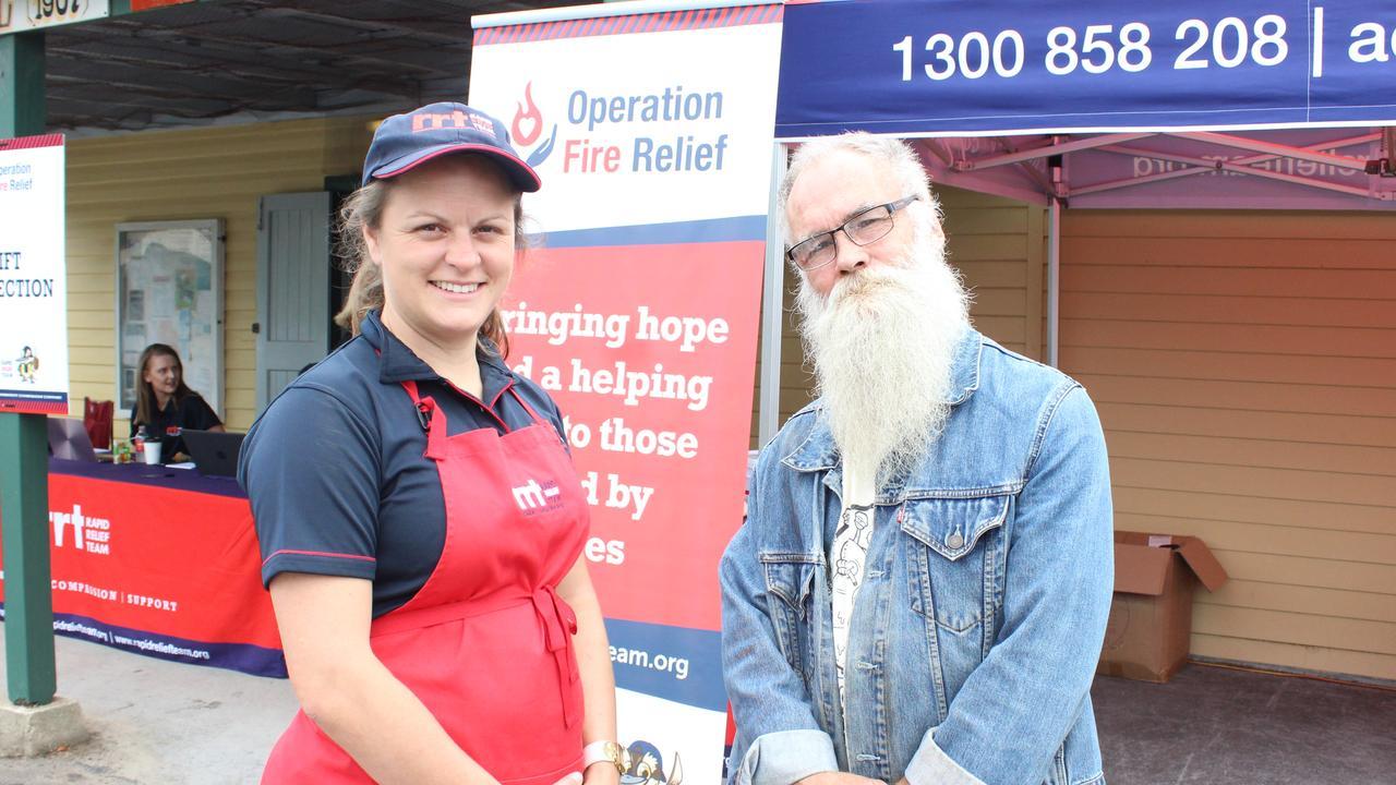 Rapid Relief Team volunteer Clare Sharples with Ian Watson at the Nana Glen Community Hall.