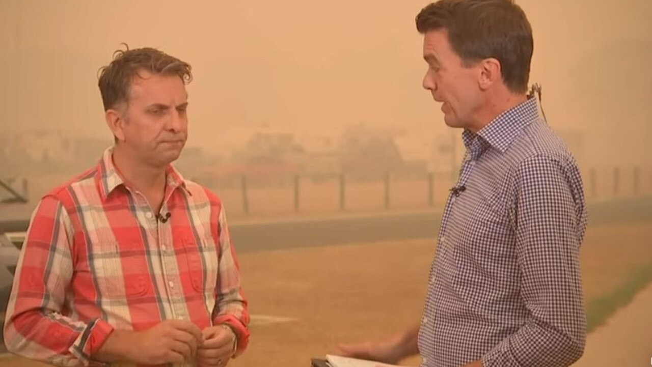 An emotional Andrew Constance reacts to news that hundreds of homes have been destroyed by bushfire in his electorate. Source: ABC News Breakfast.